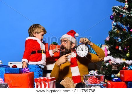 Boy And Man With Beard And Excited Faces Celebrate Christmas.