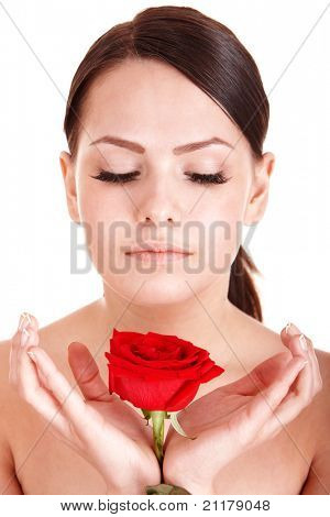 Beautiful girl with red flower. Isolated.