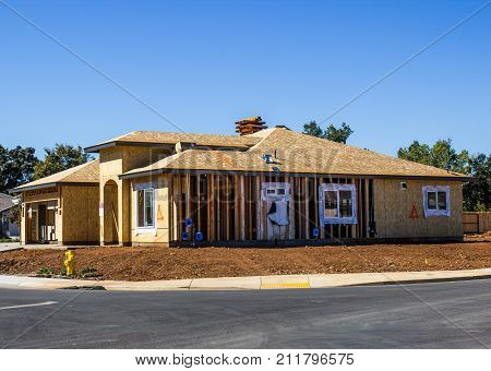 New Single Family Home Under Construction On Corner Lot