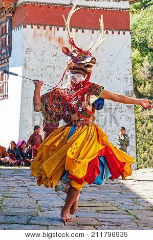 BUMTHANG, BHUTAN - OCTOBER, 25, 2010 : Masked dancer in a traditional festival in Bumthang - Bhutan