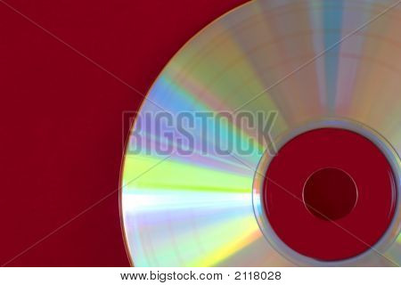Abstract Of Compact Disc On A Red Background.