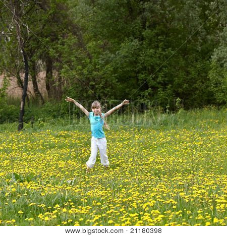 Little girl on meadow outdoor  with hand up.
