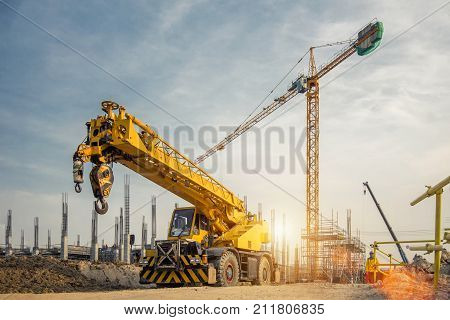 Mobile Crane on a road and tower crane in construction site