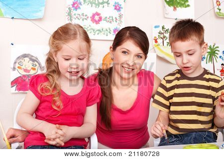 Children  preschooler with teacher in play room.
