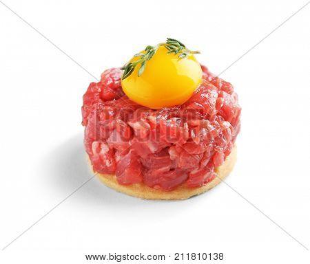 Delicious steak tartare with yolk on white background