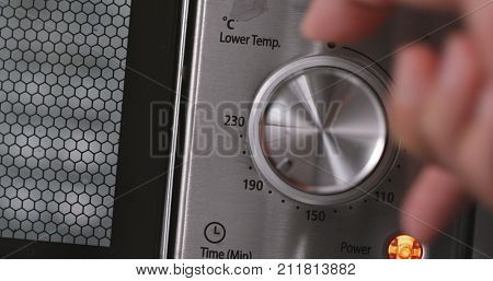 Metallic toggle switch of oven