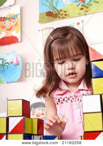 Little girl playing  block  in  preschool.