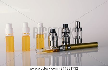 Isolated Vape Tanks And E Liquid For Electronic Cigarette Or E Cig Over A White Background. Vaping R