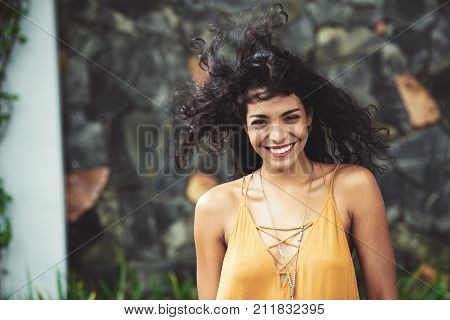 Laughing excited young woman with curly hair