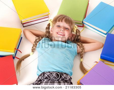 Little girl  with open book lying on floor.