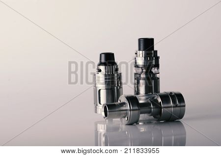 Isolated Vape Tanks For Electronic Cigarette Or E Cig Over A White Background. Vaping Heads.