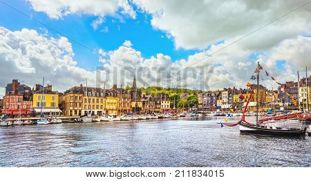 Honfleur famous village harbor skyline boats and water. Normandy France Europe.