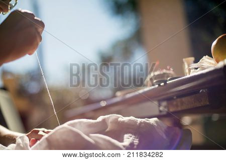Hand Of Woman Sewing With Needle And Thread