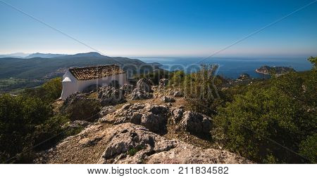 Old Small White Chapel, Ai Symeon, In Mountains Under Clear Blue Sky. Doukades, Corfu, Greece.