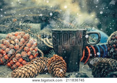 Up Of Hot Tea On A Rustic Wooden Table. Still Life Of Cones, Twine, Patskthread, Fir Branches. Effec