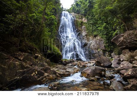 Natural background waterfall Colorful leaves waterfall thailand tropical Khao Nan National Park Sunanta Waterfall Nakhon Si Thammarat Thailand.
