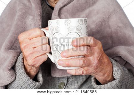 Senior ill woman on isolated covered by a warm blanket
