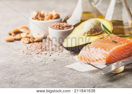 Healthy fats in nutrition - salmon, avocado, oil, nuts. Concept of healthy food