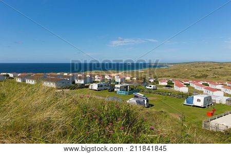 St Ives Bay Cornwall with static caravans and camping in summer with beautiful blue sky