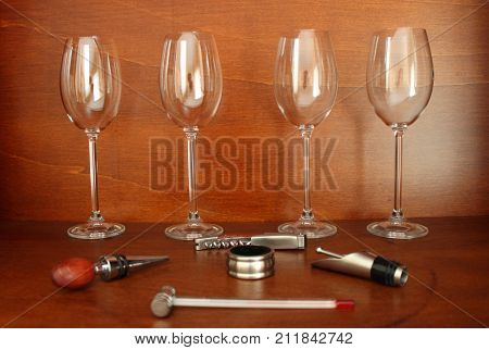 Some wine accessories on brown wood background