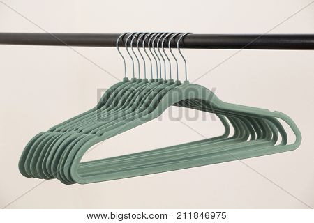 Close-up of hangers arranged on clothes rack