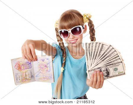 Little girl holding international passport and money. Foreign vacation.
