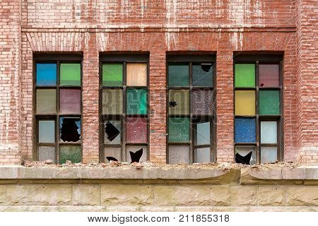 Broken Colorful stained glass windows on old brick building in downtown Portland Oregon being demolished