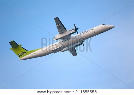 BUDAPEST, HUNGARY - OCTOBER 18: AirBaltic Dash 8 taking off at Budapest Airport, October 18th 2014. AirBaltic operates daily flight between Budapest and it's base, Riga.