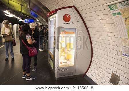 Foreigner travlers asian women buying food and drink from Automatic vending machine at underground subway station of Paris Metro on September 6 2017 in Paris France