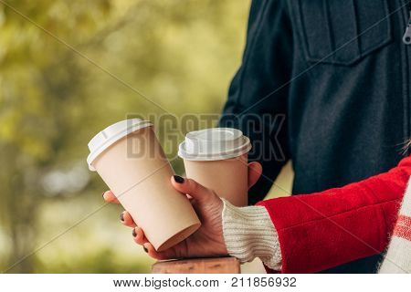 Couple With Paper Cups