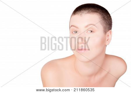 Portrait of positive woman with bald haircut with bare shoulders on isolated white background