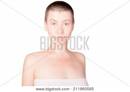 Portrait of woman with bald haircut with bare shoulders on isolated white background