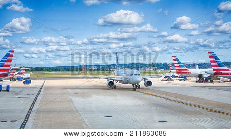 September 10 2017 Washington DC USA: American airlines planes pull up the gates on a sunny day at Reagan National Airport in Washington.