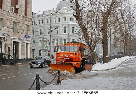 Moscow Russia - December 11 2016: Snowplow cleans from the road snow in Moscow