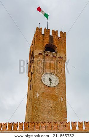 Treviso Civic Tower close up. Ancient civic tower of Treviso in Piazza dei Signori Treviso Veneto Italy. Piazza dei Signori Treviso.