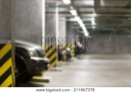 Almost Empty Underground  Parking Garage. Industrial Loft Concrete Dark  Interior Background. Blurre