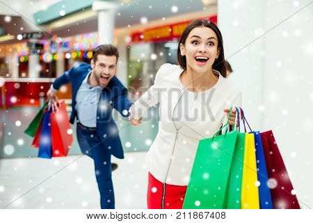 Hurry Faster! It's Shopping Time And Fun, Winter Sale. Handsome Cheerful Successful Happy Man Holdin