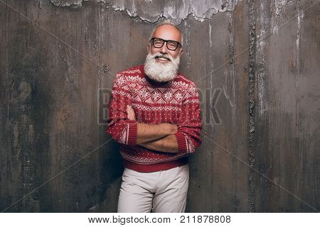 Modern beautiful Santa Claus in fashionable clothes. Beautiful senior man bearded in Christmas sweater. Merry Christmas and a happy new year 2018!