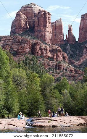 SEDONA, ARIZONA, OCTOBER 11. Oak Creek on October 11, 2017, near Sedona, Arizona. A Group of Tourists Enjoy Oak Creek at the Base of Cathedral Rock Near Sedona in Arizona.