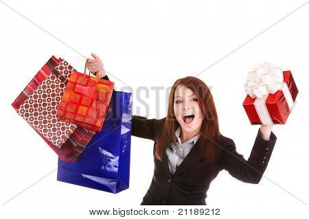 Young woman holding  shopping bag and gift box. Isolated.