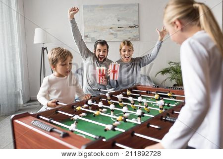 Siblings Playing Table Football