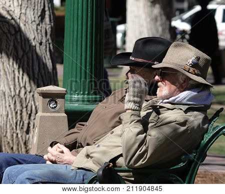 SANTA FE, NEW MEXICO - MARCH 31, 2007: Two old friends sitting on the bench in Santa Fe, New Mexico.