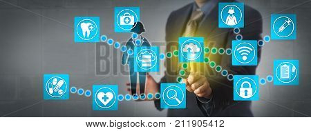 Faceless health care sector administrator transferring patient data via cloud computing applications. Healthcare technology concept for cloud computing services facilitating a seamless data system.