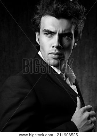 Confident Ambitious Handsome Man With Strained Look Posing In Fashion Suit And White Style Shirt On