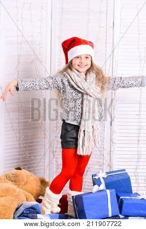 Santas Helper In Hat Holds Toy Bear Near Gift Boxes