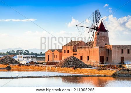 Marsala Italy. Stagnone Lagoon with vintage windmills and saltwork Trapani province Sicily.