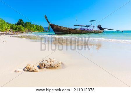 Traditional longtail boat moored at Aonang beach