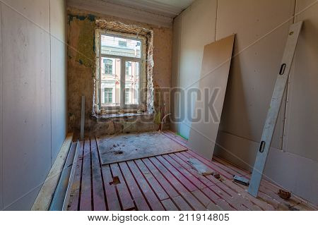 Interior of apartment with materials during on the remodeling renovation extension restoration reconstruction and construction.(upgrading wall from gypsum plasterboard or drywall and double-glazing window or double glass pane)