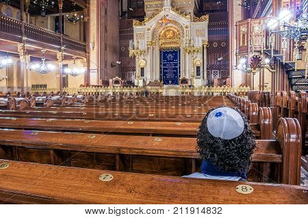 BUDAPEST, HUNGARY - November 17: A Jew prays with the kippah in the interior of the Dohány Street Synagogue, Budapest