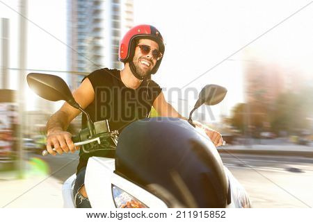Handsome Man On Motorcycle Ride In City Smiling